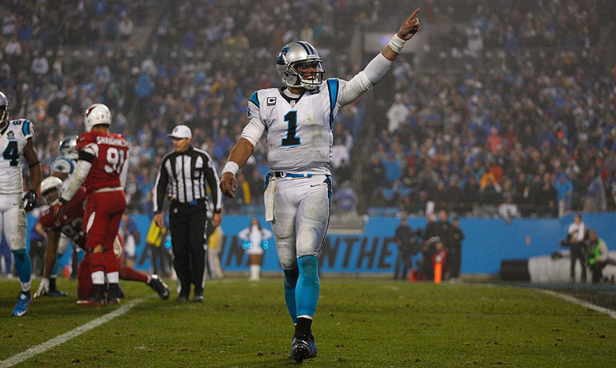 Cam Newton's first career playoff win came in his second attempt. (Chris Keane/Sports Illustrated/The MMQB)