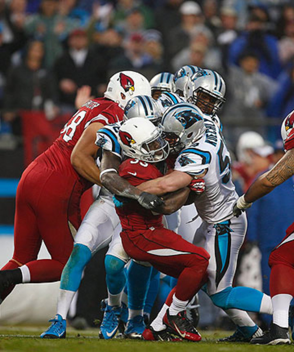 Luke Kuechly and the Panthers defense smothered the Cardinals ground game, allowing just 27 yards on 15 attempts. (Chris Keane/Sports Illustrated/The MMQB)
