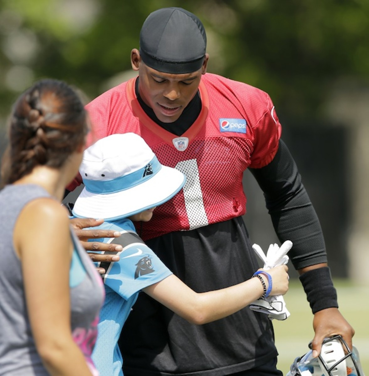 cam-newton-carolina-panthers-angry-mom-fan-letter-hugging-fan.jpg