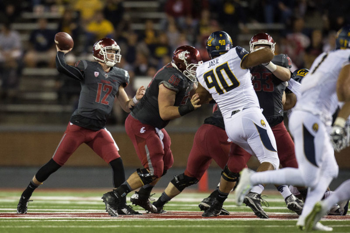 Halliday threw for an NCAA-record 736 yards in a 60-59 loss to Cal on Oct. 4. (Dean Hare/AP)