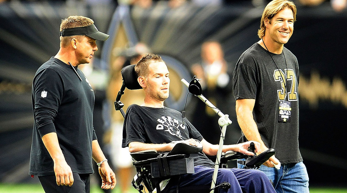 Former Saints special teamer Steve Gleason (center) was diagnosed with ALS in 2011.