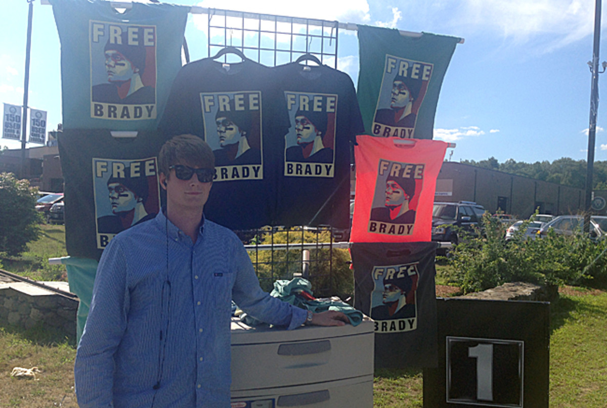 William Carr has had no problem selling 'Free Brady' t-shirts on Route 1 leading up to Gillette Stadium. (Jenny Vrentas/The MMQB)