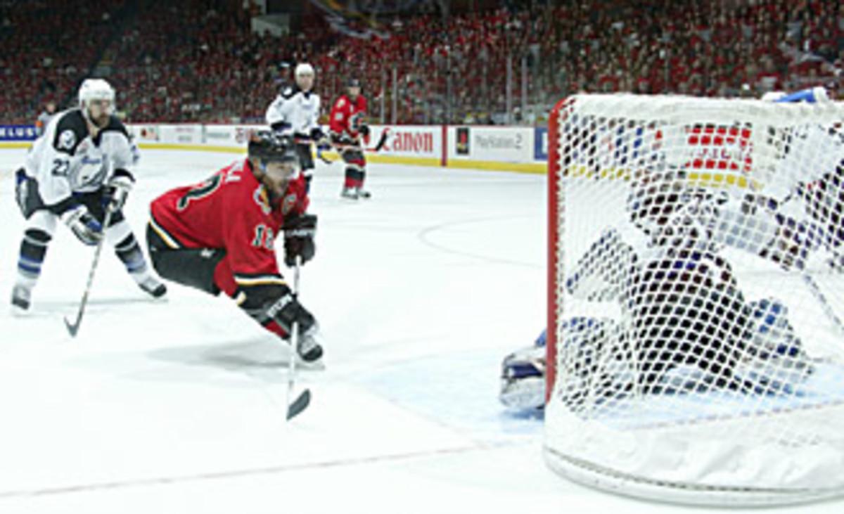 Flames captain Jarome Iginla scores on Lightning goalie Nikolai Khabibulin.