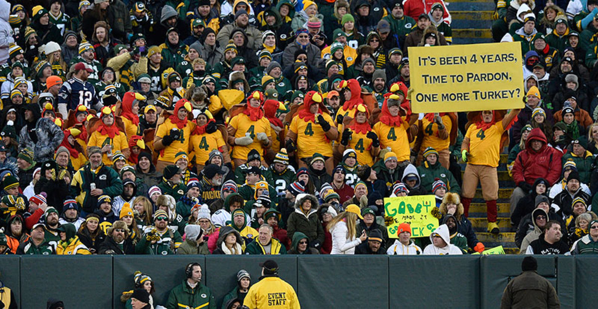 Eventually, some Packers fans forgave Favre for playing for the rival Vikings, as this sign showed at a November 2014 game at Lambeau Field. (Brian D. Kersey/Getty Images)