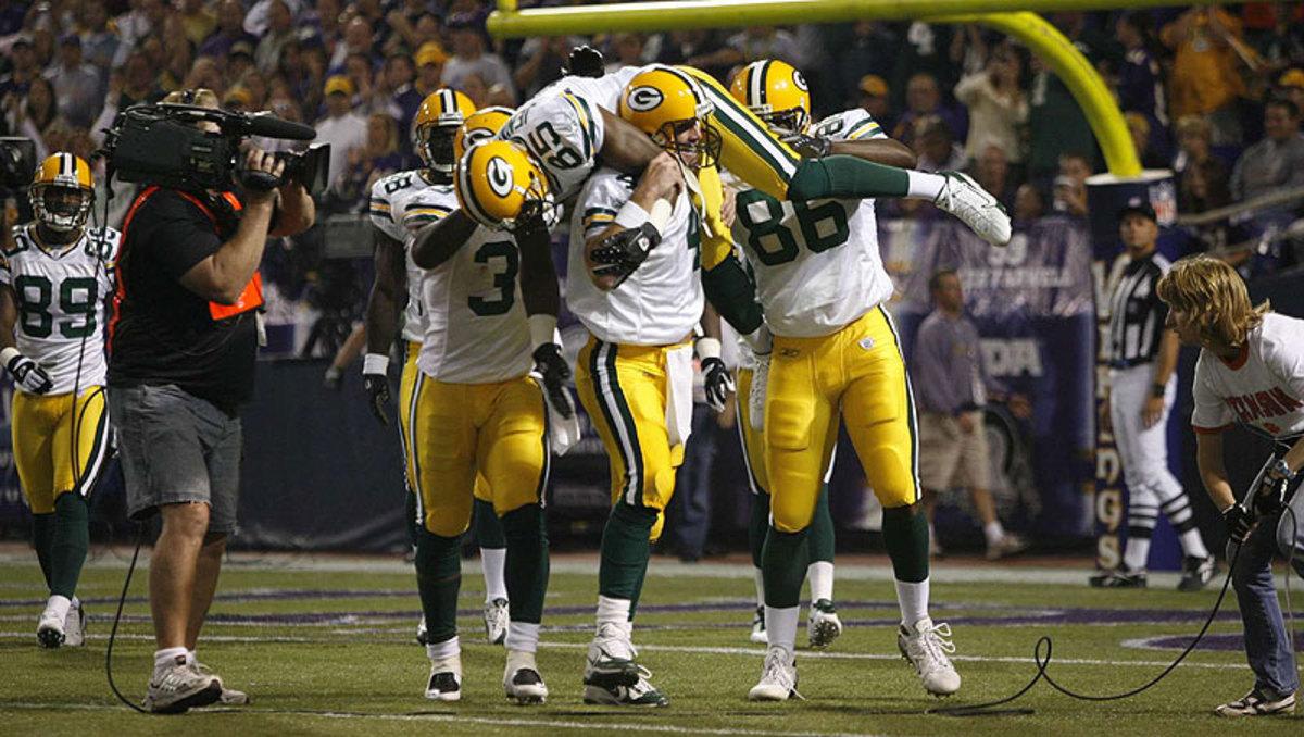 Brett Favre lifted Greg Jennings onto his shoulders after breaking Dan Marino's touchdown record in 2007. (John Biever/Sports Illustrated)