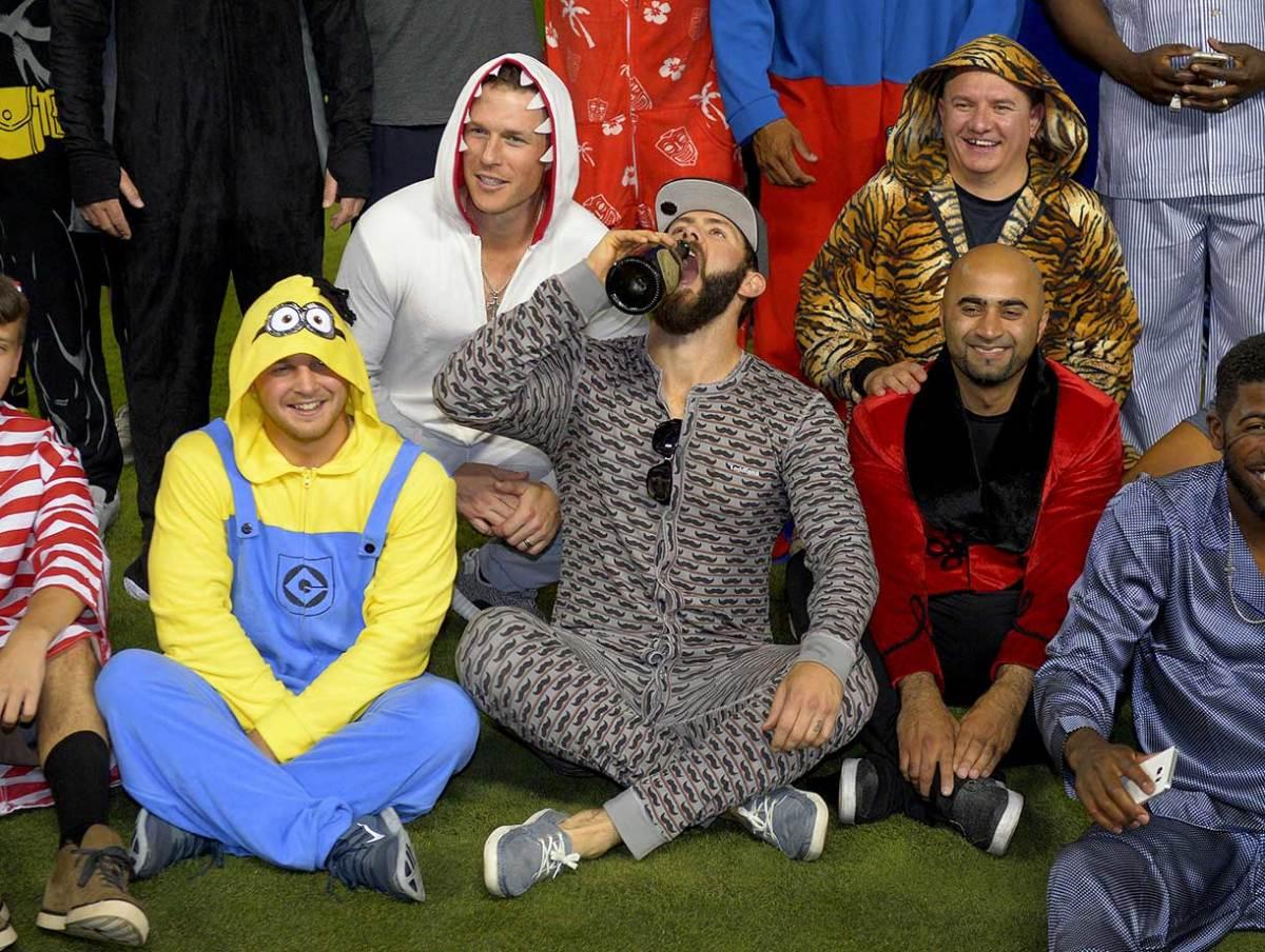 Chicago-Cubs-pajama-party-onesies-Jake-Arrieta-champagne.jpg