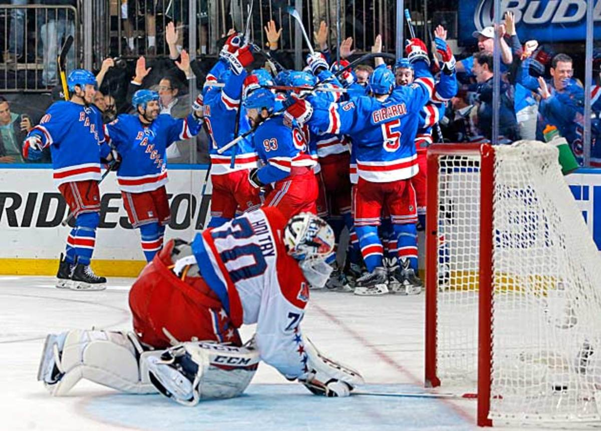 Capitals goalie Braden Holtby (70) reacts after the Rangers scored in OT to end their second-round series.