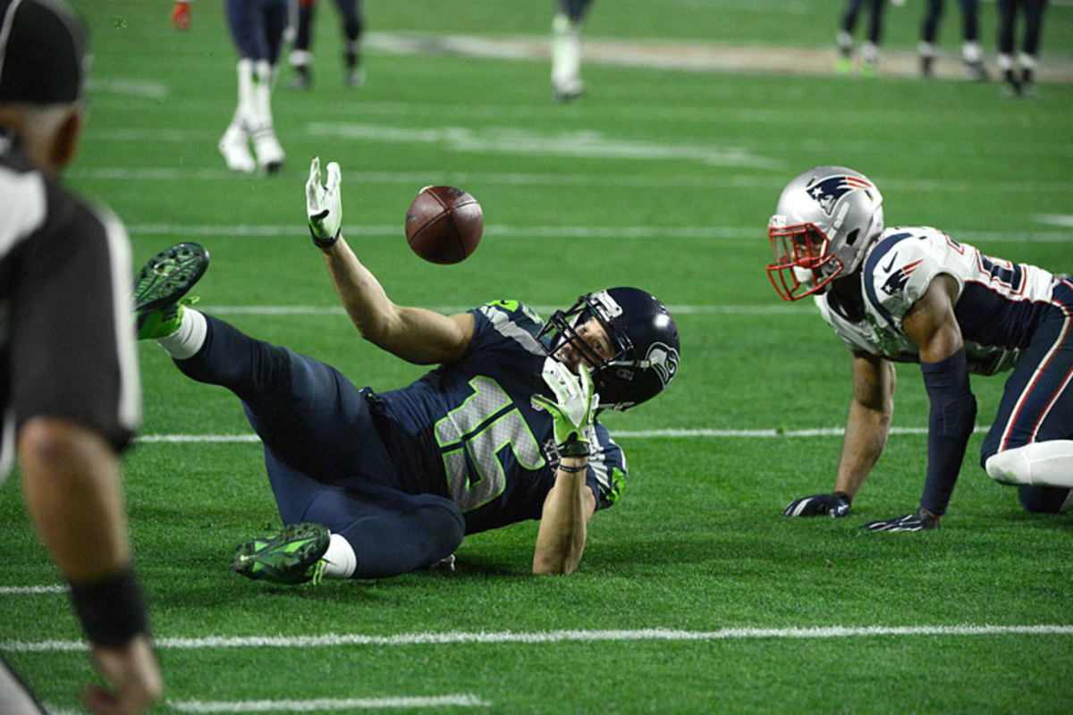 When this ball miraculously landed in Kearse's hands, it seemed the Patriots were on their way to more heartbreak in Glendale. (Donald Miralle/SI/The MMQB)