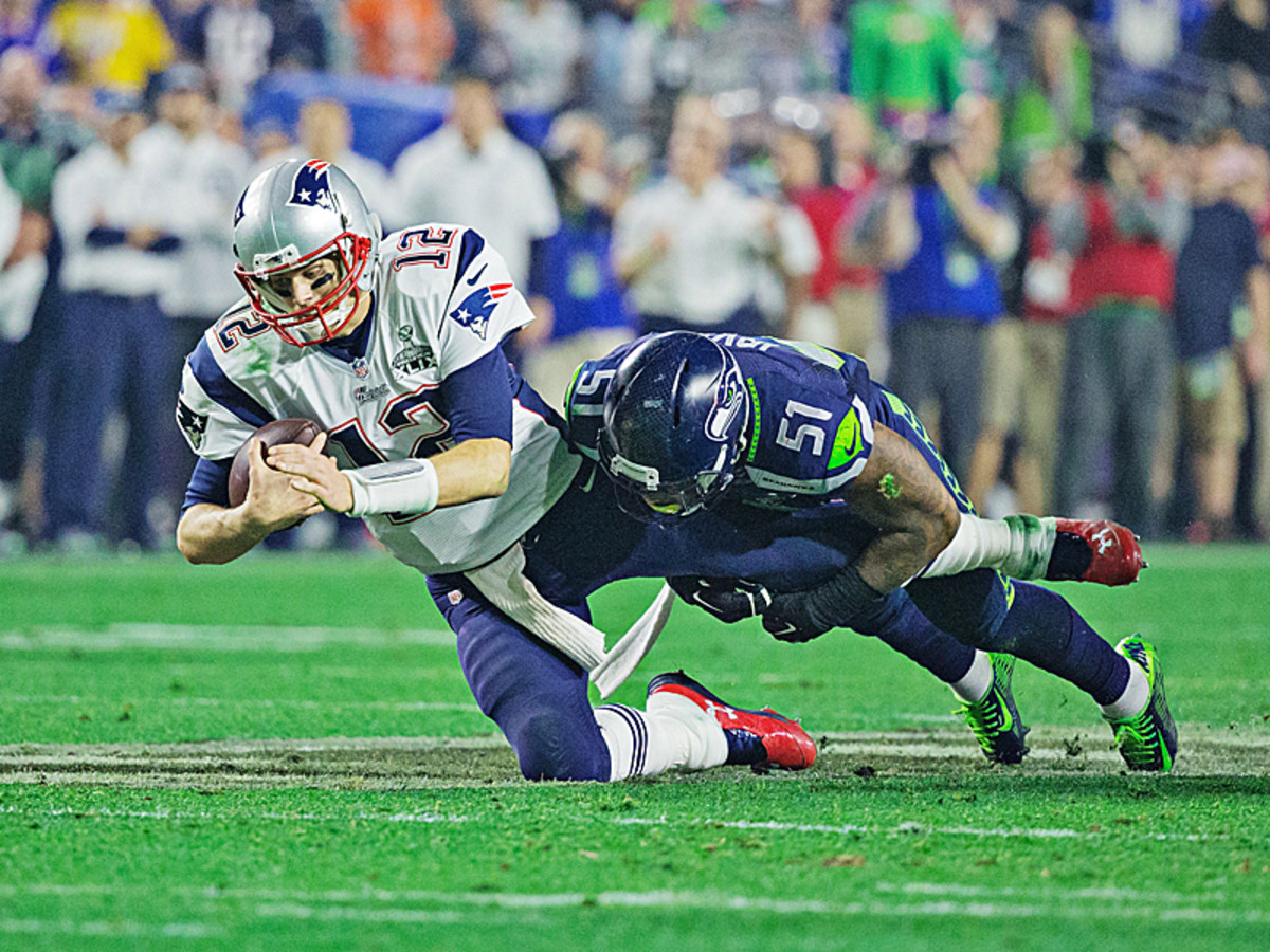 The first of New England's two fourth-quarter scoring drives started with Brady being sacked by Bruce Irvin. (Simon Bruty/SI/The MMQB)