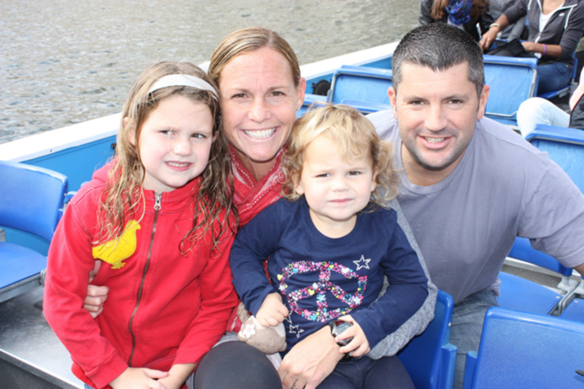 USWNT captain Christie Rampone with her daughters Rylie and Reece and husband Chris.