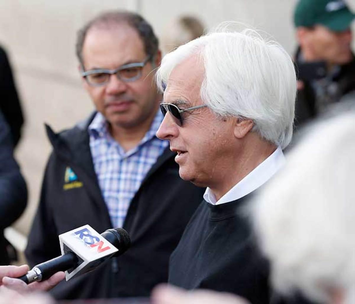 American Pharoah's owner, Ahmed Zayat (above, left), listens to Bob Baffert, the colt's trainer.