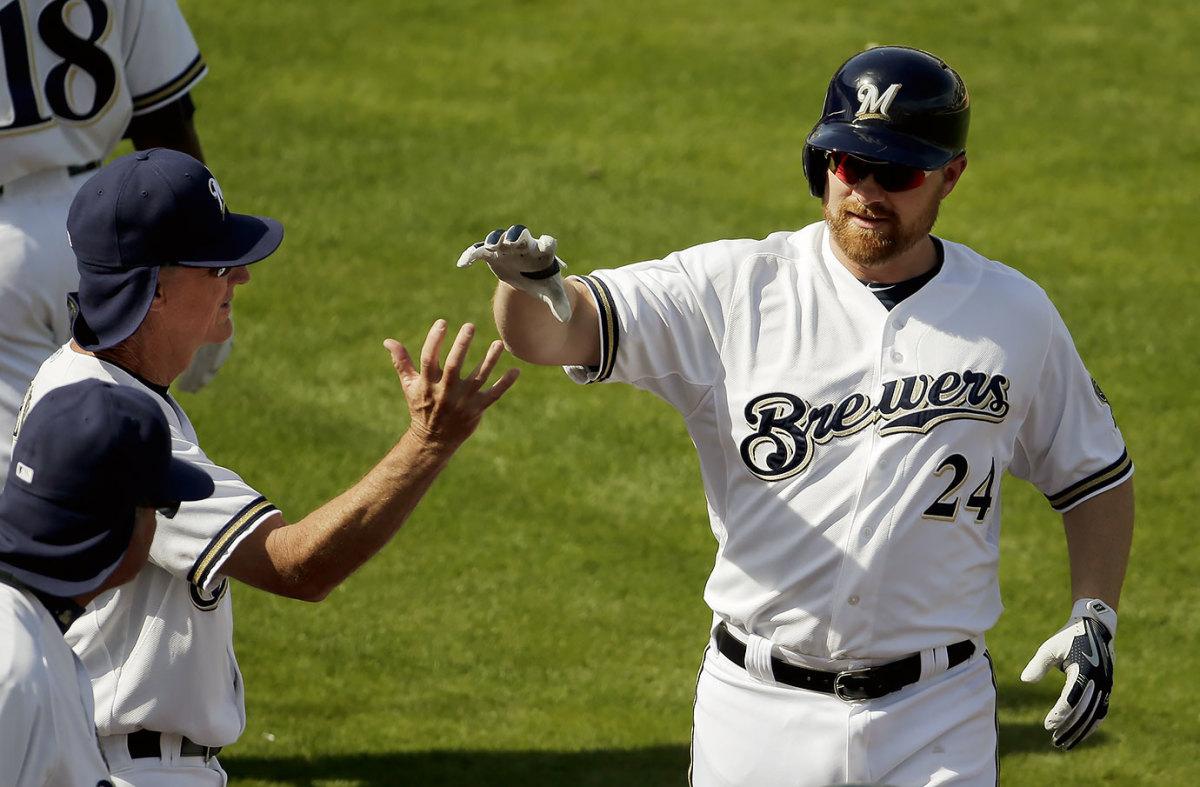 2015-0323-Milwaukee-Brewers-Adam-Lind-Ron-Roenicke-high-five.jpg
