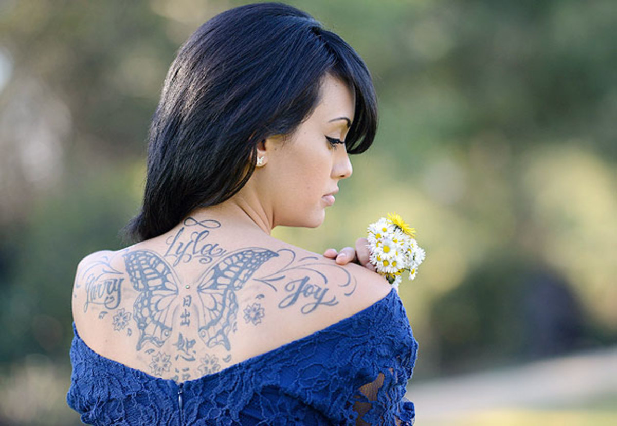 A tattoo on Bryan's back bears the names of her parents and four-year-old daughter Lyla.