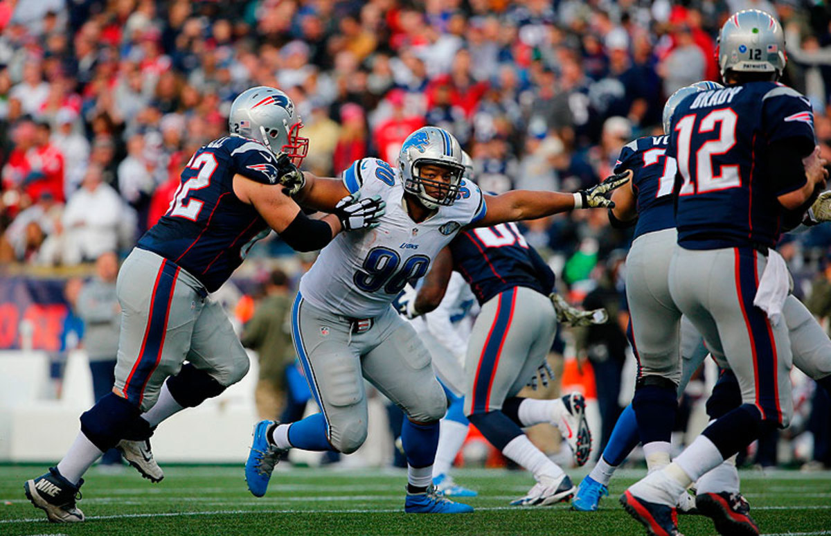 Ndamukong Suh's ability to pressure Tom Brady up the middle was a central reason the Dolphins broke the bank to land the prized free agent. (Winslow Townson for Sports Illustrated/The MMQB)