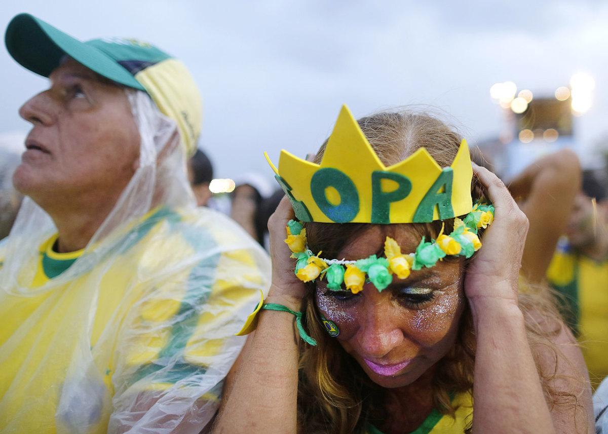 distraught-brazil-fans-9e81f36bf5c940c9b4a7a3fa7c64563a-0.jpg