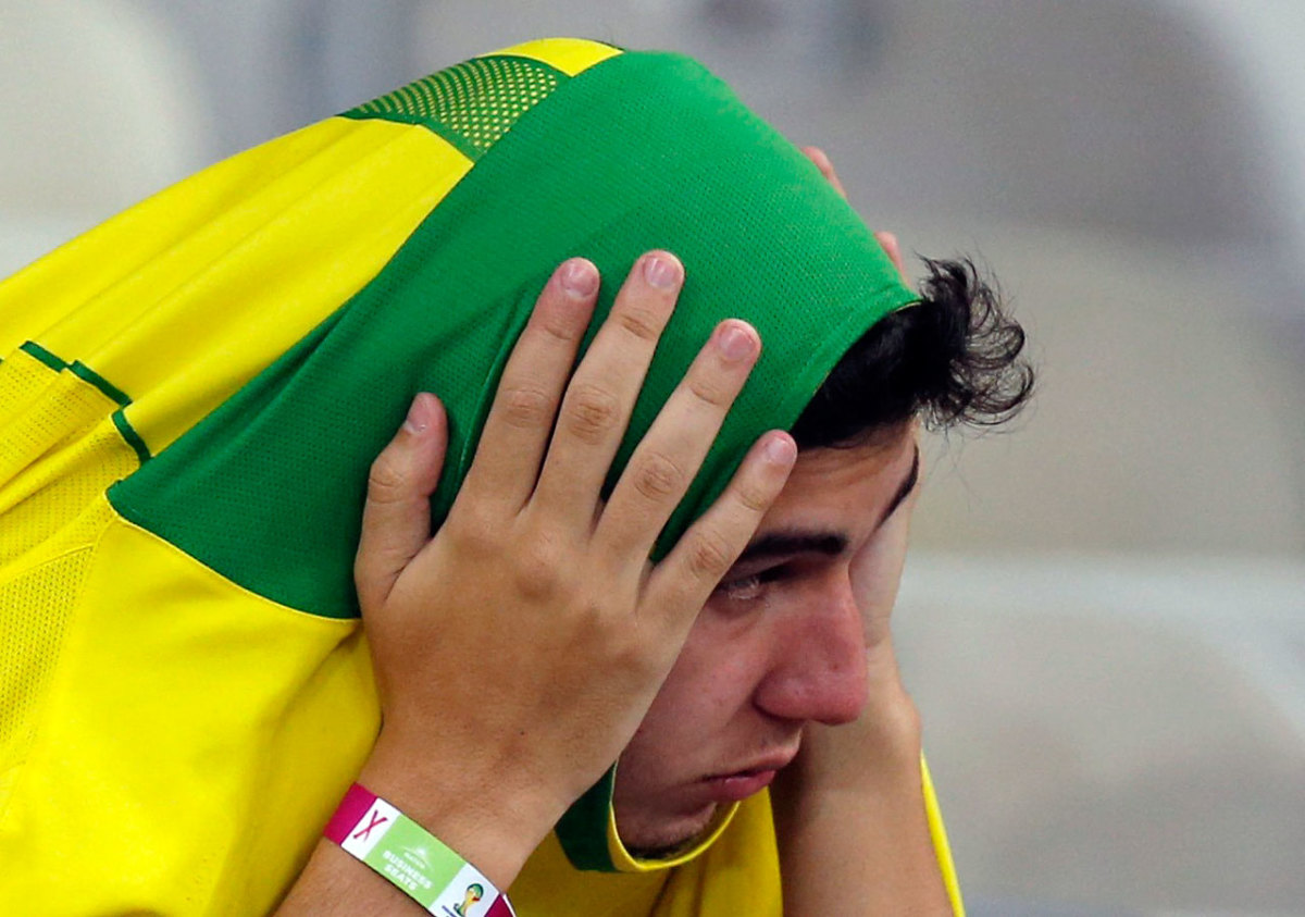 distraught-brazil-fan-c1ce29ebd2e74bf287272224dd5fda54-0.jpg