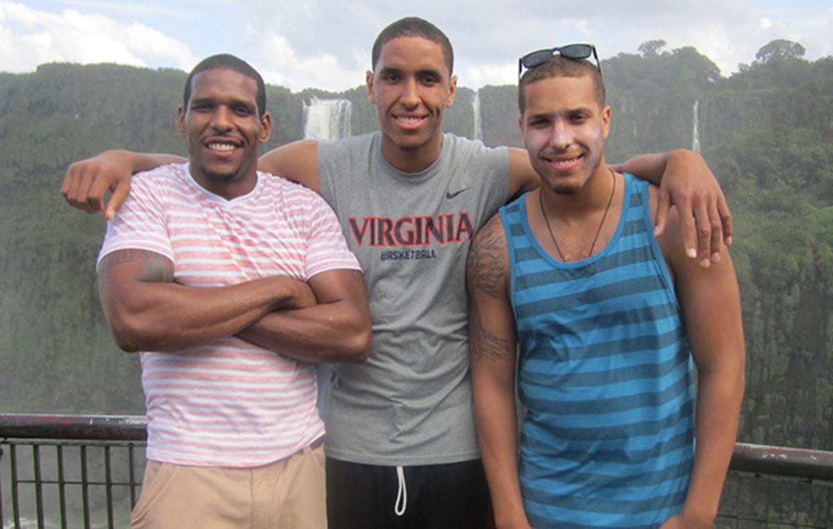 Brogdon stands with his brothers in front of Iguazu Falls in Brazil.