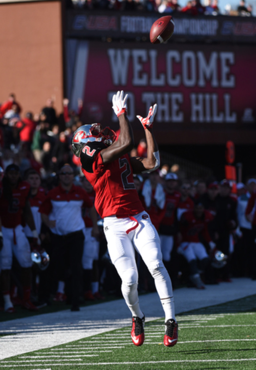 Western Kentucky wide receiver Taywan Taylor (2) makes a catch during the first half against Southern Mississippi in a NCAA college football Conference USA championship game on Saturday, Dec. 5, 2015, at L.T. Smith Stadium in Bowling Green, Ky. (AP Photo/