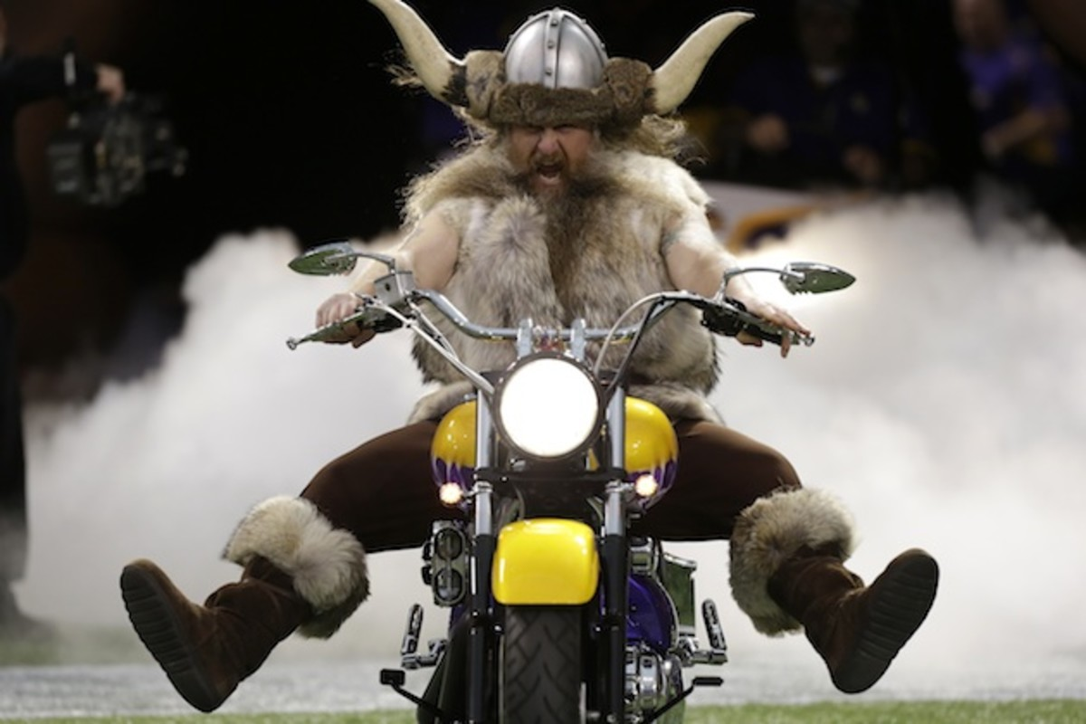 Ragnar rides out of the tunnel on his trademark purple motorcycle.