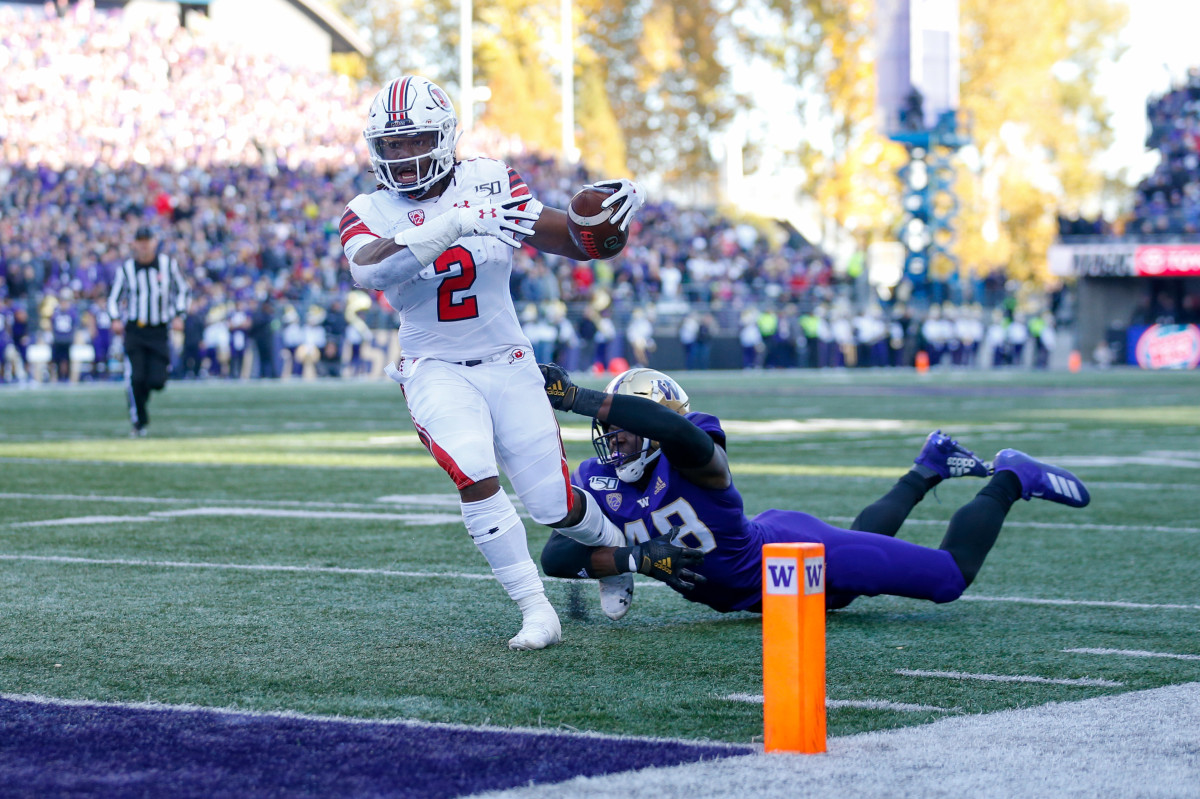 Nov 2, 2019; Seattle, WA, USA; Utah Utes running back Zack Moss (2) drags Washington Huskies linebacker Edefuan Ulofoshio (48) into the end zone for a touchdown during the second quarter at Husky Stadium