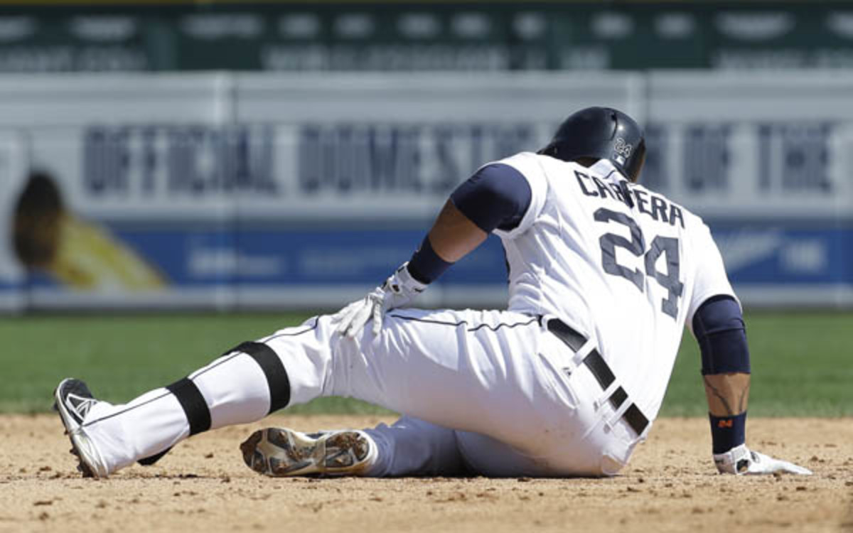 Tigers slugger Miguel Cabrera grabs his leg after sliding into second base. (AP Photo/Paul Sancya