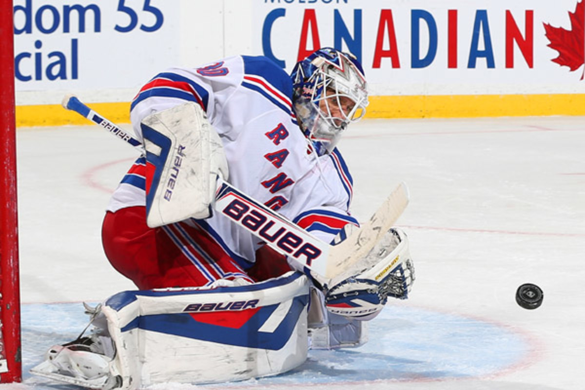 Henrik Lundqvist got his 302nd win as a Ranger to pass Mike Richter's wins record. (Andre Ringuette/Getty Images)