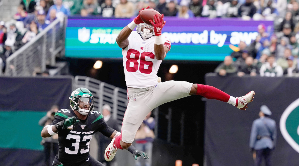Nov 10, 2019; East Rutherford, NJ, USA;  New York Giants wide receiver Darius Slayton (86) hauls in a reception in the 3rd quarter against the Jets as New York Jets strong safety Jamal Adams (33) defends at MetLife Stadium. Mandatory Credit: Robert Deutsch-USA TODAY Sports