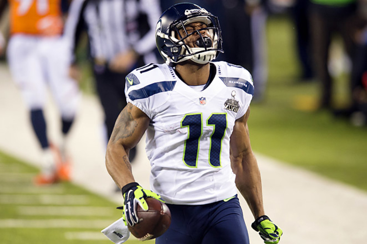 Percy Harvin's kickoff return for a TD was just one of many key plays for Seattle in its rout of Denver.