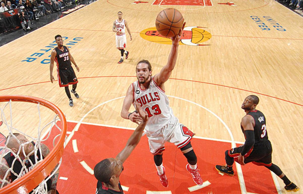 Joakim Noah helped the Bulls outscore Miami 9-2 in OT and earn a split in their season series.