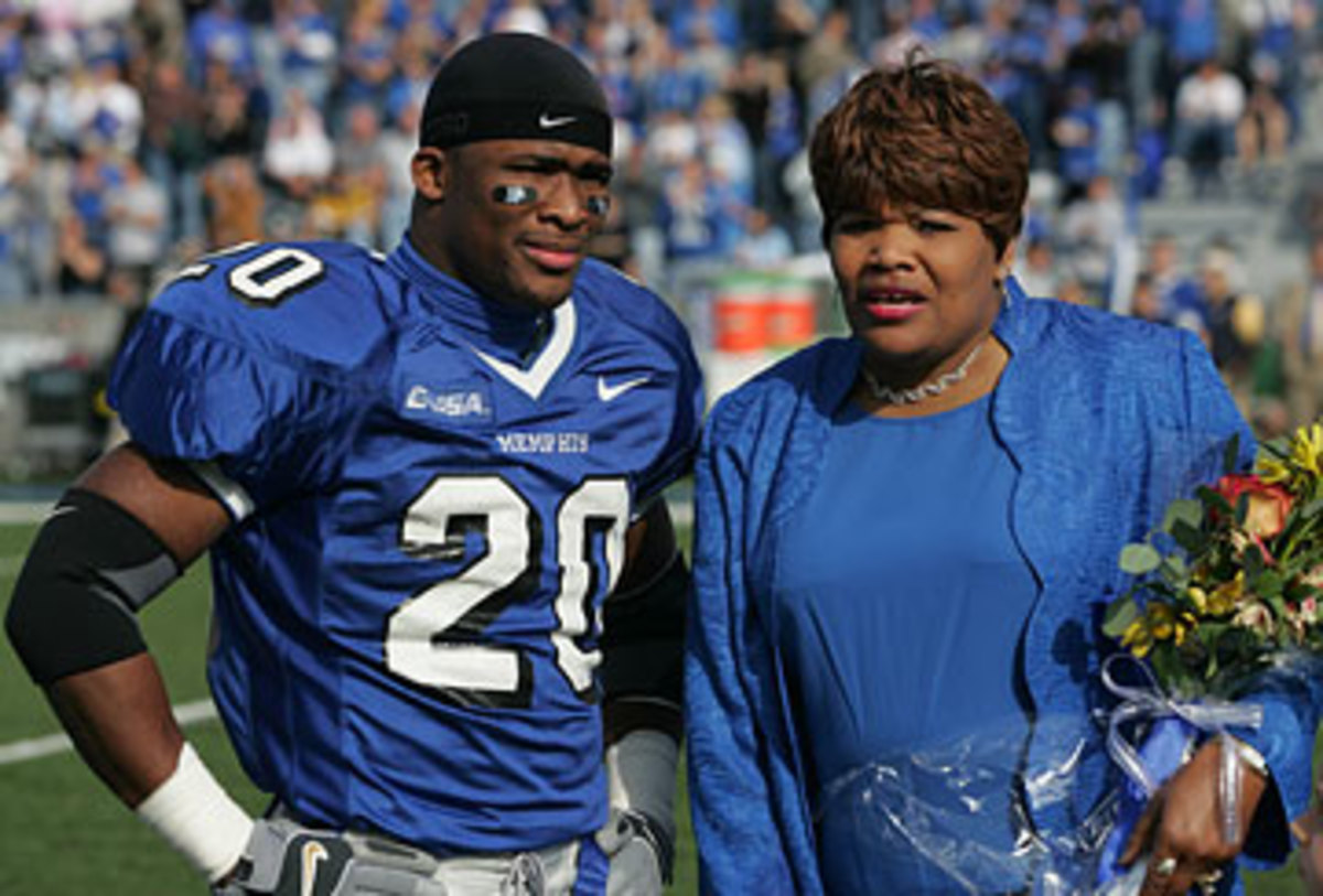 DeAngelo Williams and his mom, Sandra Kay Hill, before a Memphis game in November 2005. ( Nelson Chenault/US PRESSWIRE)
