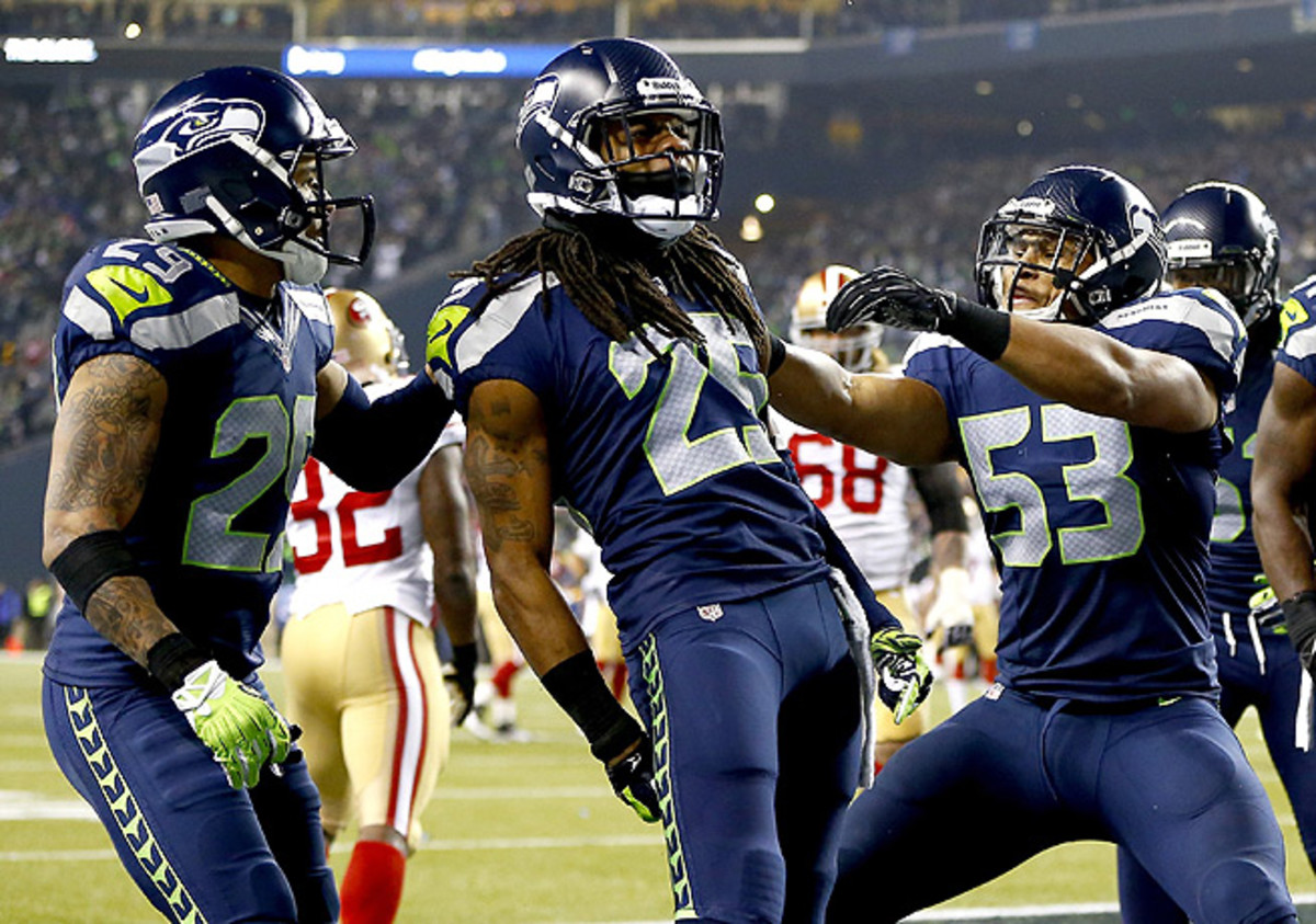 Richard Sherman (center), the brash leader of Seattle's defense, made a victory-sealing play against the 49ers.