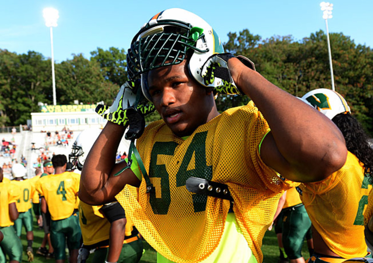Woodbridge (Va.) Senior defensive end Da'Shawn Hand is the top-ranked prospect in the class of 2014.