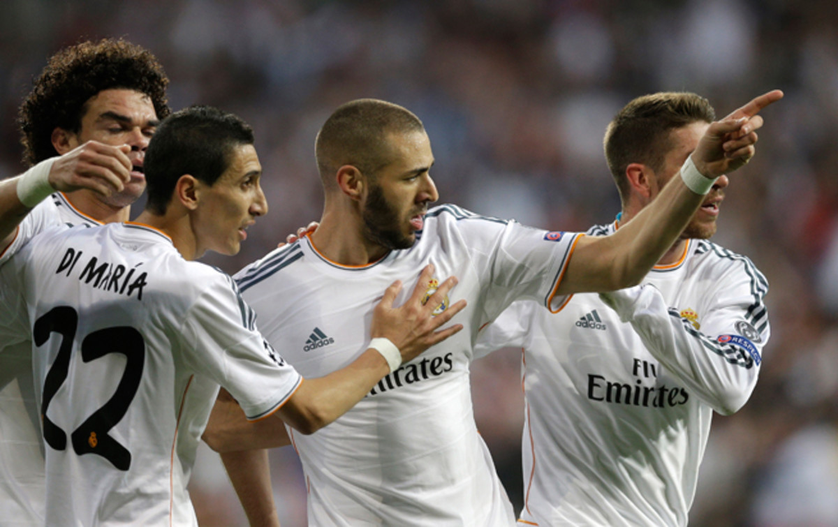 Karim Benzema, third from left, is congratulated by Pepe, Angel di Maria and Sergio Ramos after his 19th-minute goal gave Real Madrid a 1-0 lead over Bayern Munich.