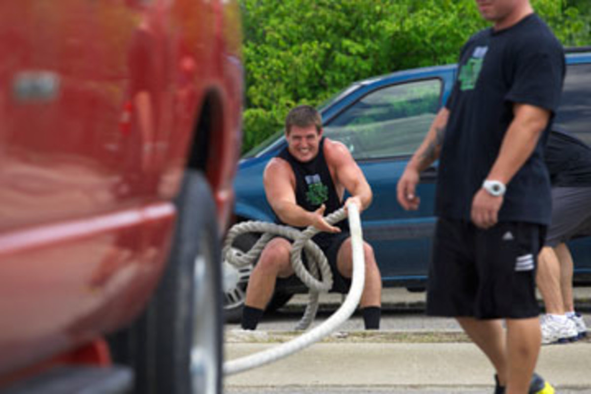 Despite his torn shoulder labrum, Line was able to pull this truck last July. (John DePetro/The MMQB)