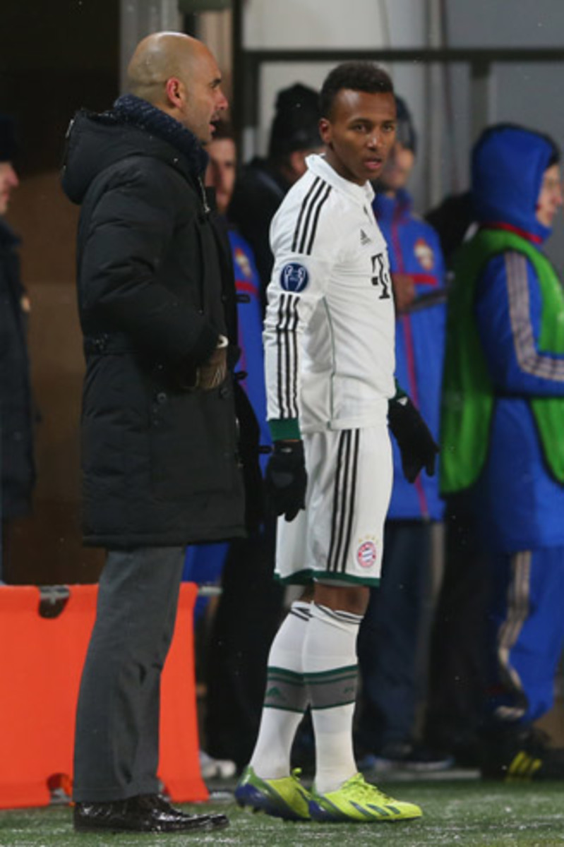 Julian Green gets instructions from manager Pep Guardiola before taking the field in the Champions League for Bayern Munich against CSKA Moscow.