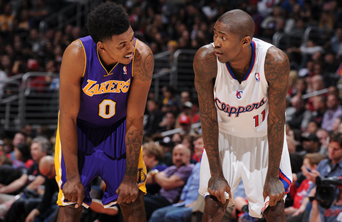 Trading places: The lowly Lakers are stuck in the Western cellar, while the Clips look like contenders.
