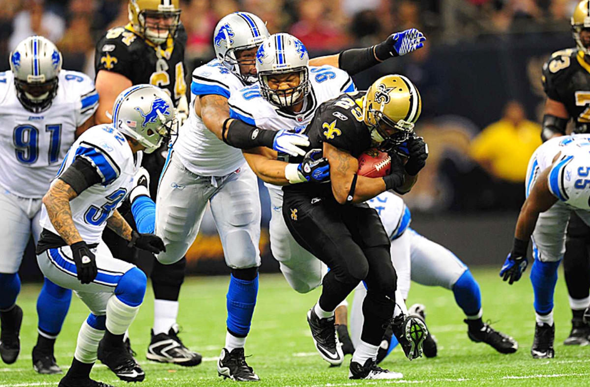 Ndamukong Suh and the front four will key a new-look defense. (Al Tielemans/Sports Illustrated)