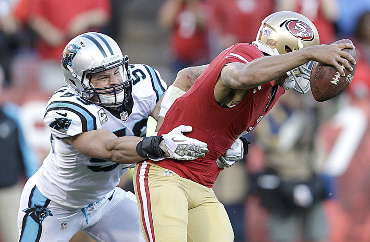 Reining NFL Defensive Player of the Year Luke Kuechly anchors a front seven that is still one of the NFL's best. (Marcio Jose Sanchez/AP)
