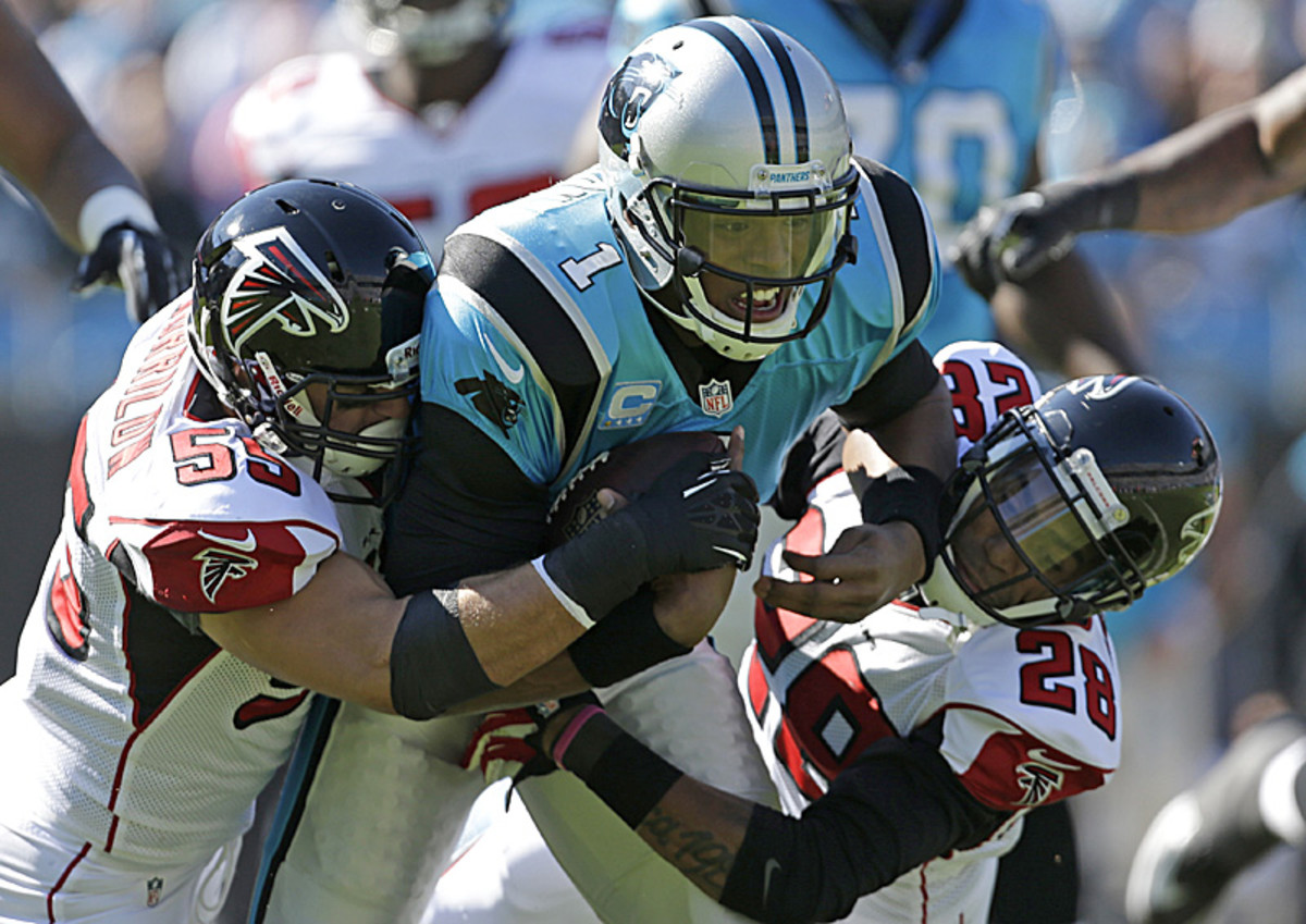 Cam Newton will have his work cut out for him this fall. (Bob Leverone/AP)