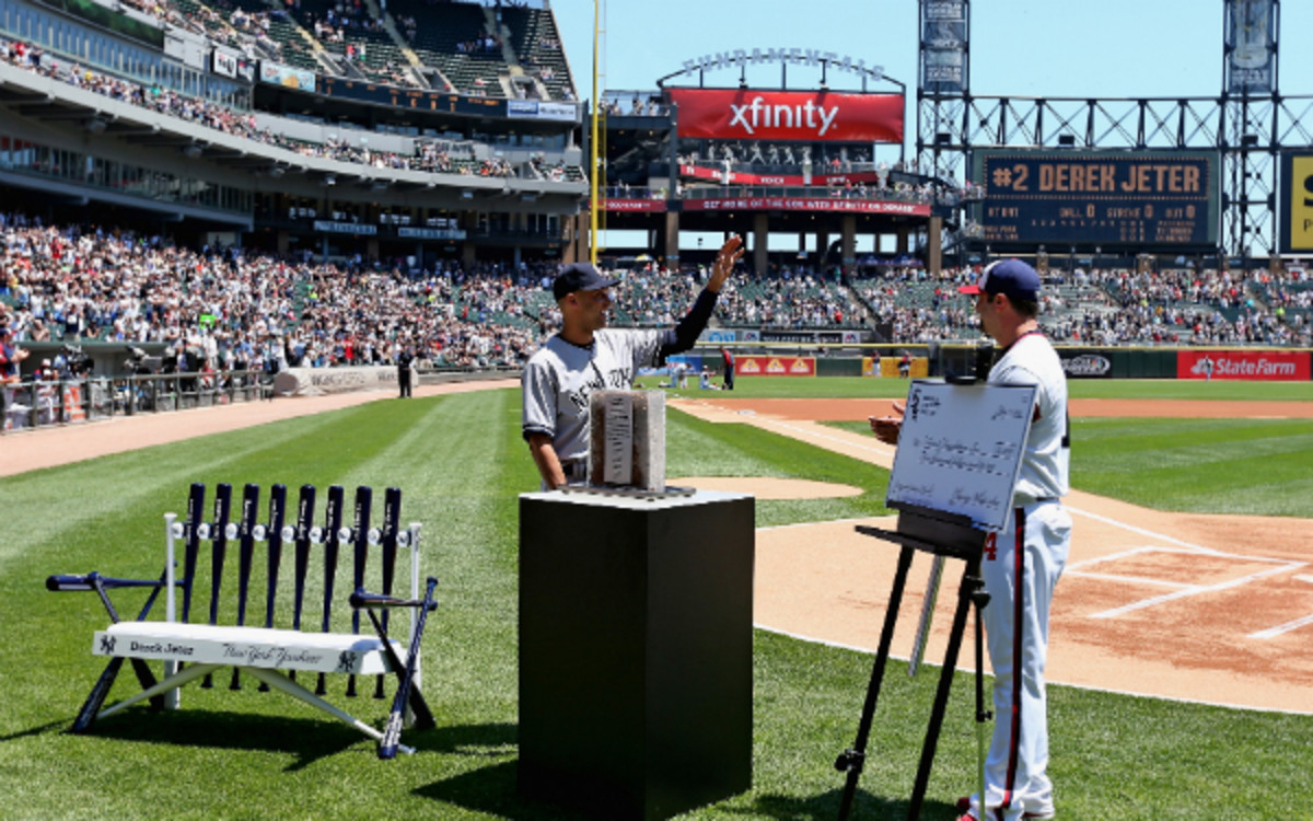 White Sox veteran Paul Konerko presented Derek Jeter with his farewell gifts on Sunday. (Jonathan Daniel/Getty Images)