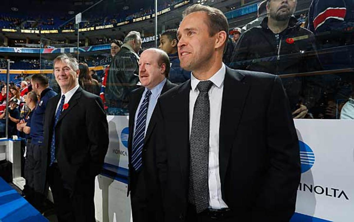 """Sabres goalie coach Arturs Irbe (right) said about possibly playing, """"Be careful what you wish for."""""""