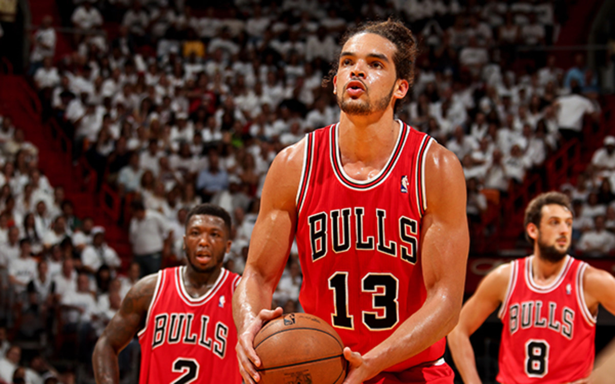 Joakim Noah averaged 12 points and 11 rebounds a game in 2012-13. (Issac Baldizon/NBAE via Getty Images)