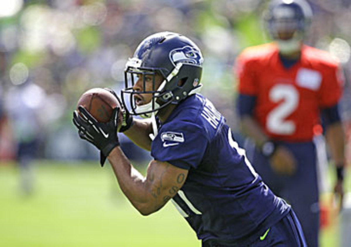 Percy Harvin pulling down a catch at Friday's practice. (AP)