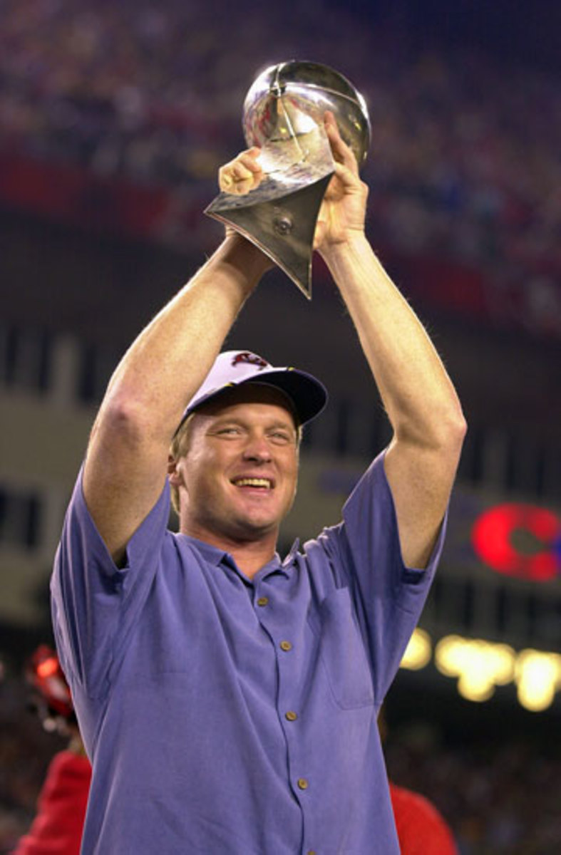 Gruden raising the Lombardi Trophy at Raymond James Stadium a day after winning Super Bowl 37. His Bucs rolled to a 48-21 victory over the Raiders, the coach's former team. (Scott Martin/AP)