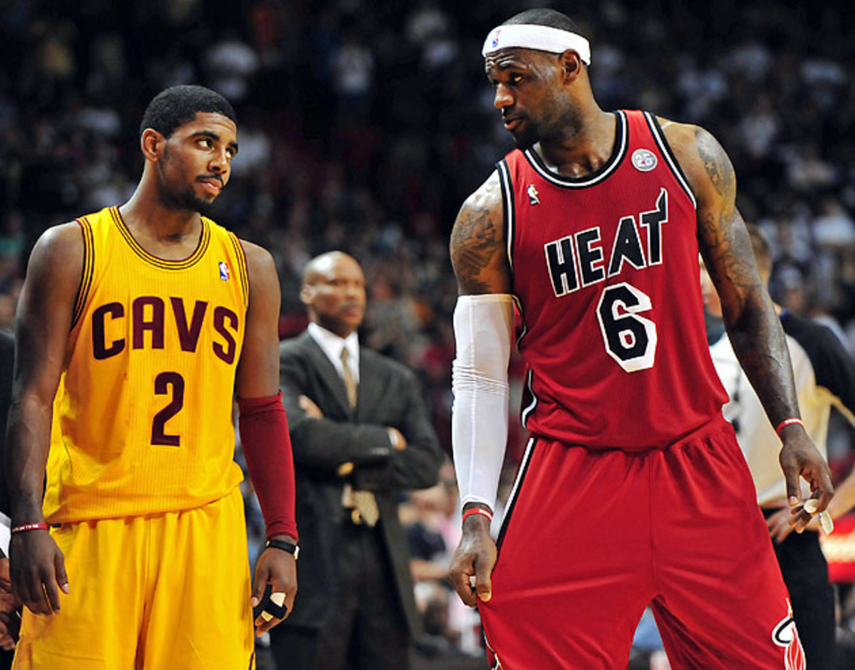 Former No. 1 pick Kyrie Irving (left) hasn't made the playoffs in his three seasons with the Cavs, but LeBron James will provide immediate help.
