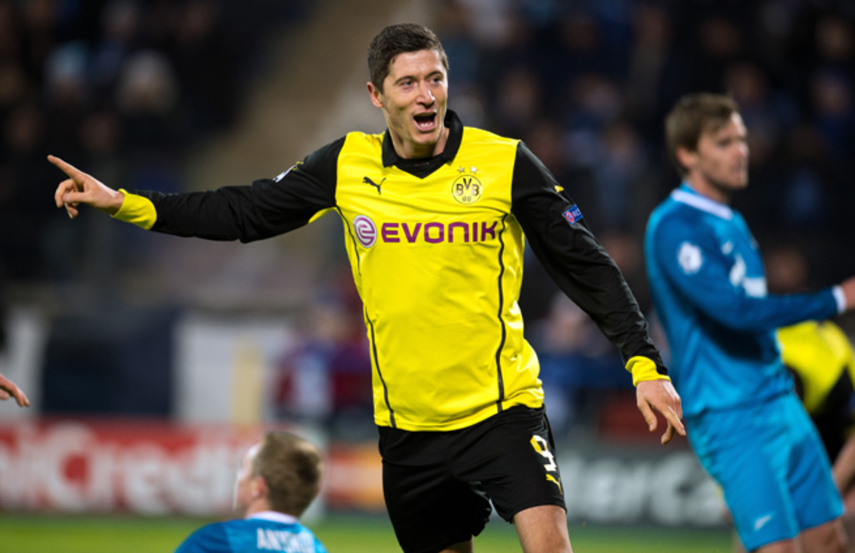 Robert Lewandowski celebrates one of his two goals in Borussia Dortmund's 4-2 win over Zenit in the Champions League on Tuesday.
