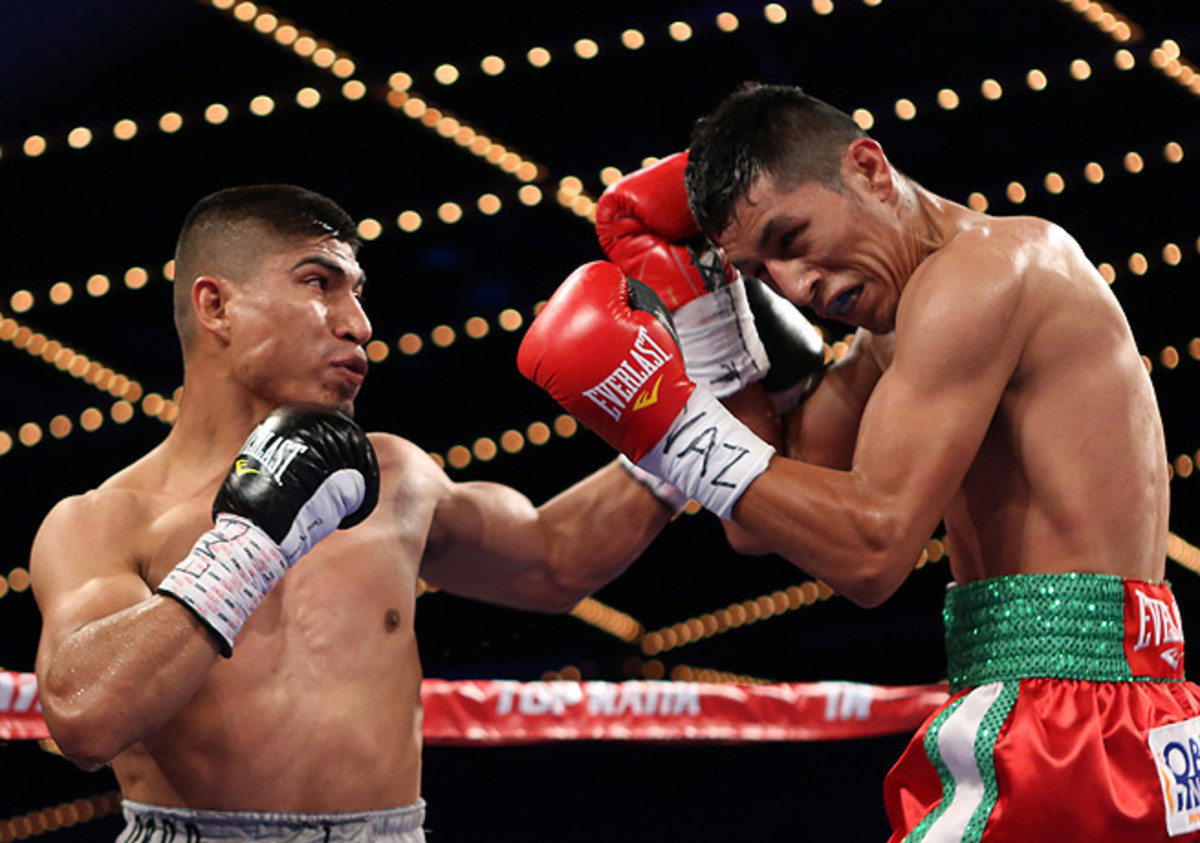 Mikey Garcia (left) was rarely seriously threatened by Juan Carlos Burgos during the fight. (Gregory Payan/AP)
