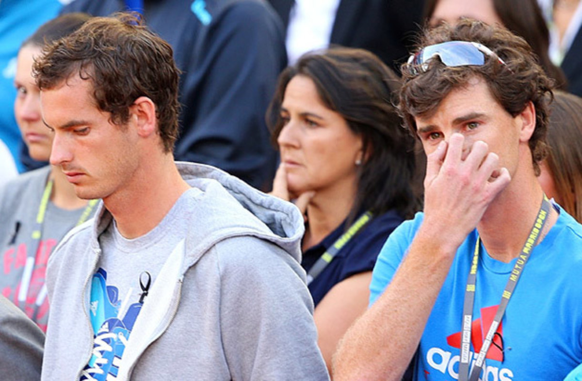 Andy Murray and Jamie Murray stand during a moment of silence for Elena Baltacha at the Madrid Open. (Clive Brunskill/Getty Images)