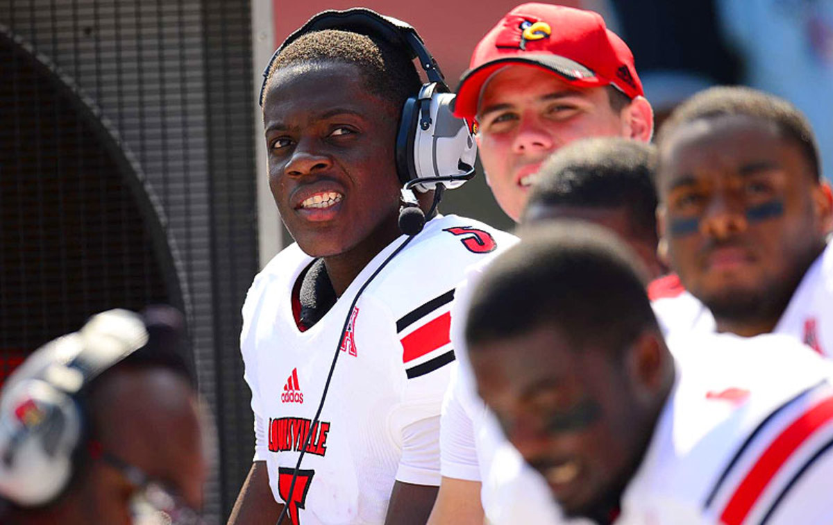 After every series, Bridgewater puts on a headset to go over each play with the offensive coordinator, who watches from the coaches box. (Al Tielemans/SI)