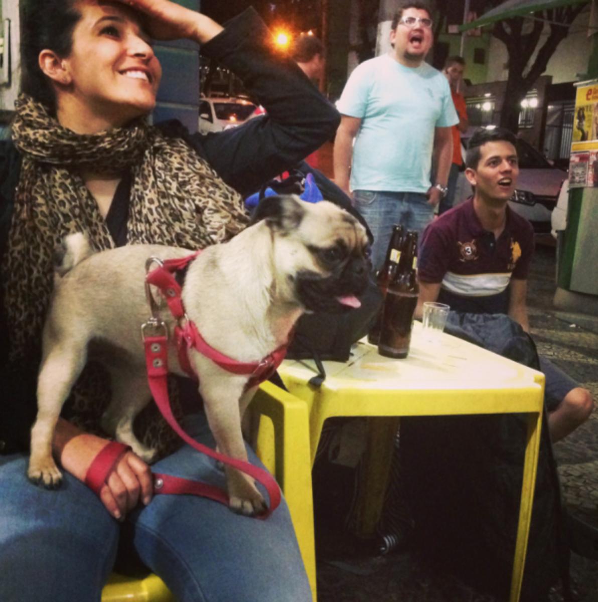 At Ponto do Espeto in the Coração Eucarístico neighborhood of Belo Horizonte, Ana Paula Rocha and friends react to a Chilean goal versus Australia.